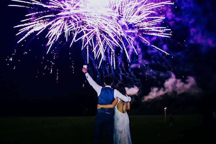 Fireworks Display   Bride in Daughters of Simone Lace Gown   Groom in Tweed Suit   Brightly Coloured Festival Wedding with Outdoor Humanist Ceremony & Tipi Reception on the Yorkshire Dales   Tim Dunk Photography