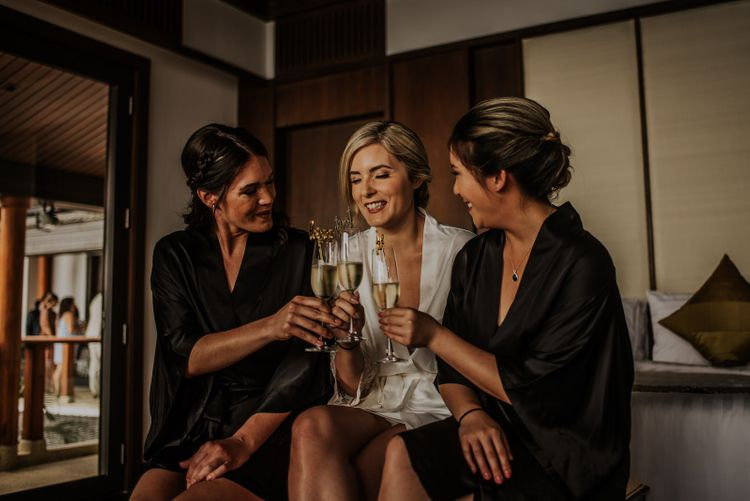Bride and bridesmaids toast the day