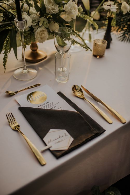 Gold wedding place setting with gold detail menu