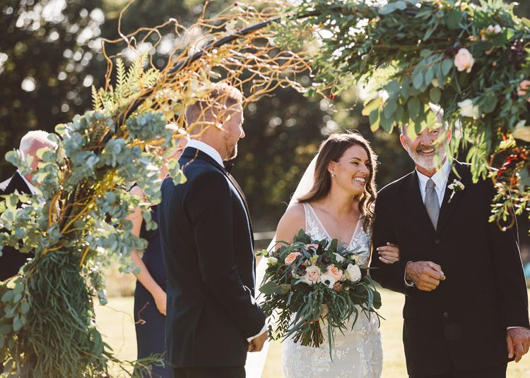 Bride and groom tie the knot at Crouchers Orchards for sophisticated outdoor ceremony