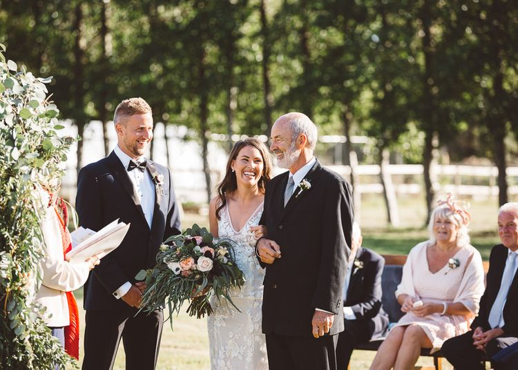 Bride wearing beautiful Made With Love Bridal dress at intimate ceremony with seven guests