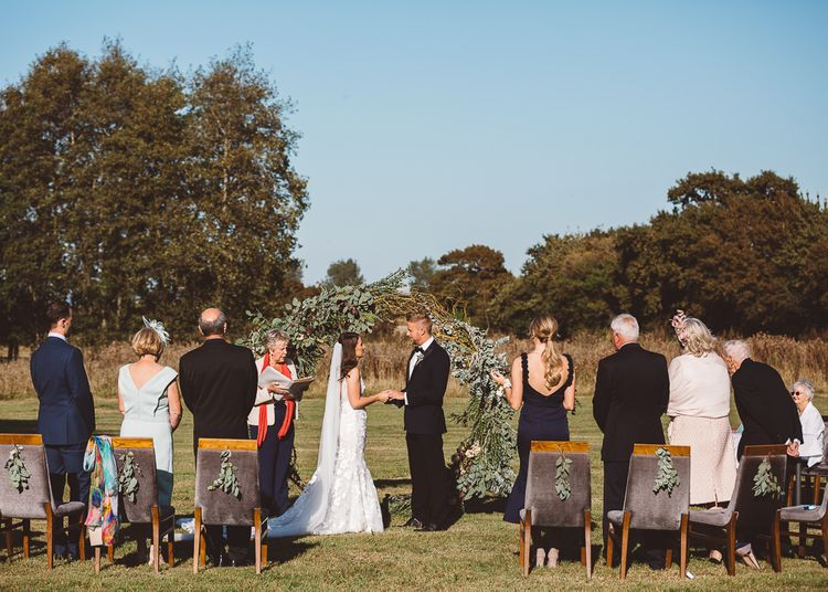 Outdoor intimate ceremony with seven guests