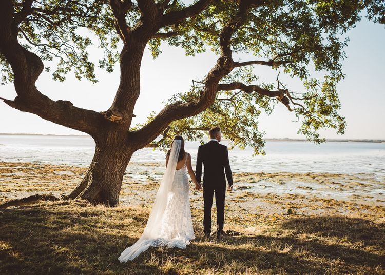 Bride and groom wearing Made With Love Bridal Dress at intimate wedding