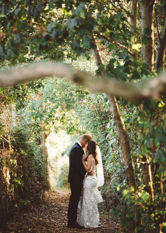Bride and groom embrace at Crouchers Orchards for outdoor wedding