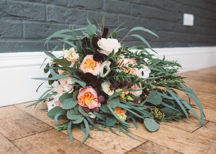 Floral and eucalyptus wedding bouquet at intimate celebration