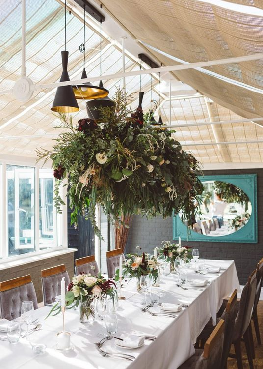 Hanging foliage styled with florals and eucalyptus for intimate reception with seven guests
