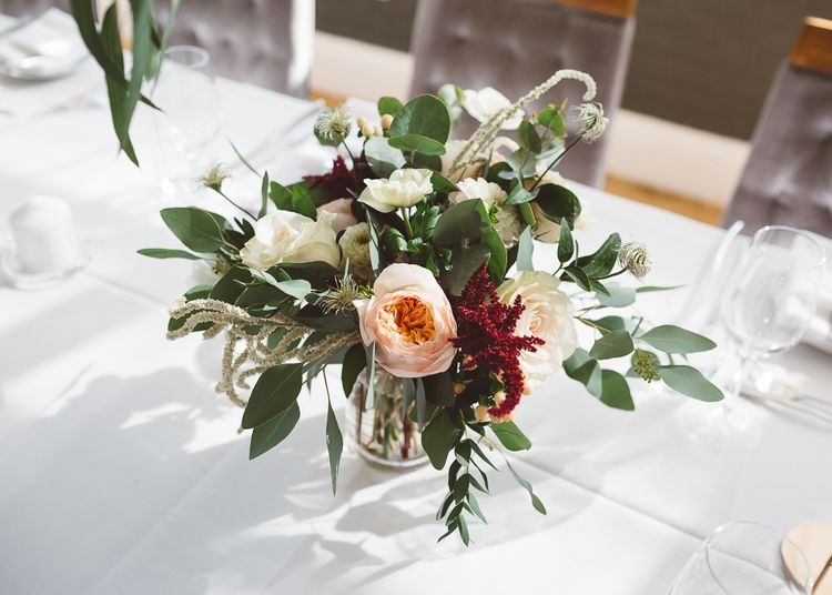 Beautiful floral table arrangements for intimate dinner reception