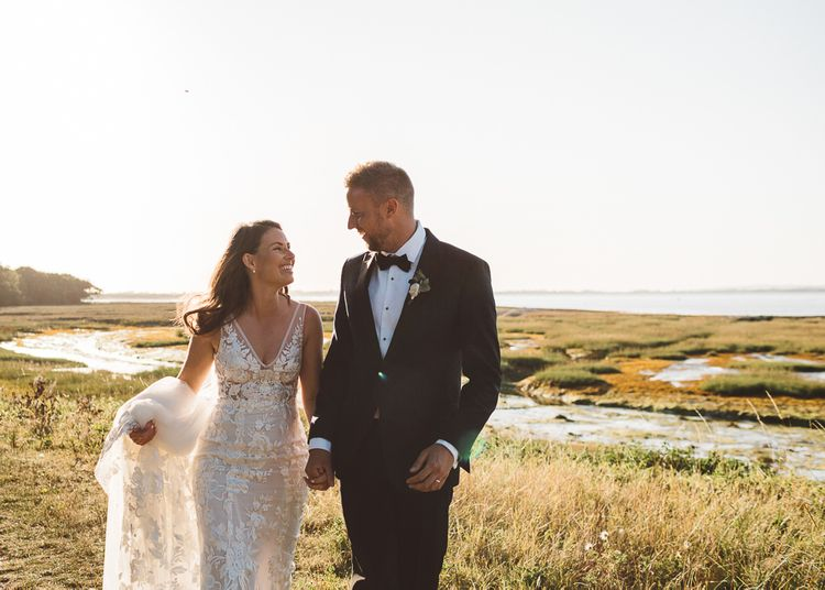 Bride and groom steal a moment together and enjoy golden hour