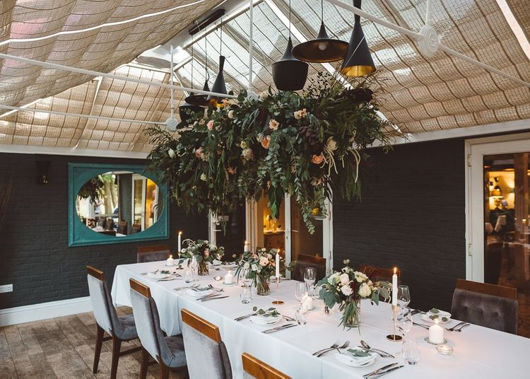Beautiful hanging foliage styled with eucalyptus for a romantic and intimate dinner