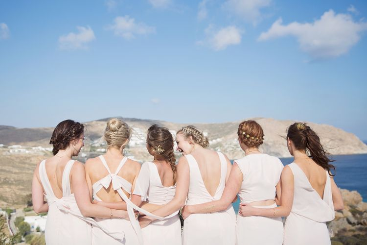 Bridesmaids in Different Blush Pink Maids to Measure Dresses Arm in Arm