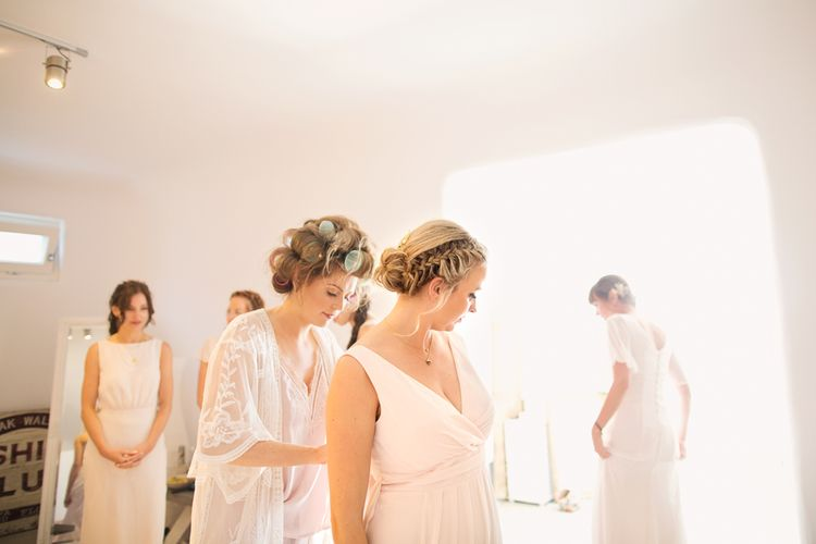 Wedding Morning Bridal Preparations with Bridesmaids Putting on their  Maids to Measure Dresses