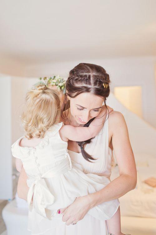 Bridesmaid Hugging Flower Girl During the Wedding Morning