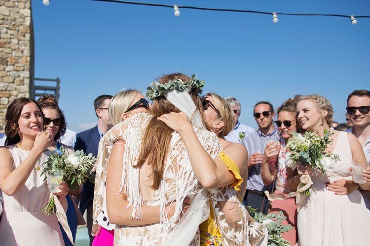 Bride in Rue De Seine Wedding Dress Embracing Wedding Guests