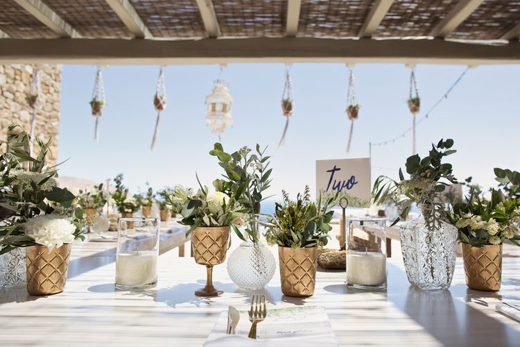 Table Wedding Decor of Flowers and Foliage Filled Vases and Goblets