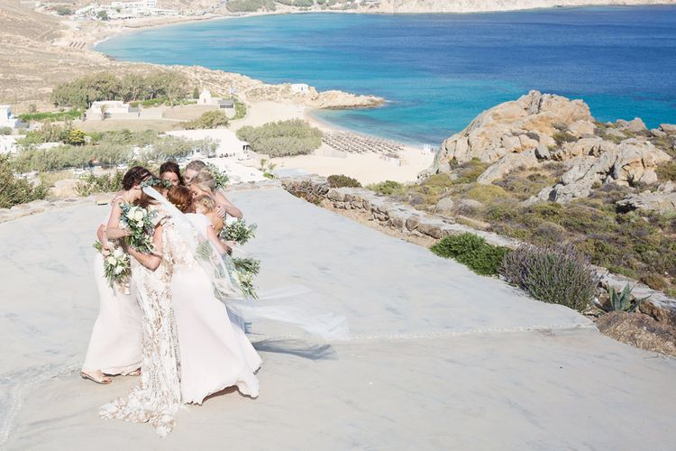 Bridal Party Hugging on the Cliff Top in Mykonos