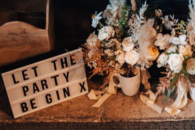 October wedding decor with dried flowers and cinema box light