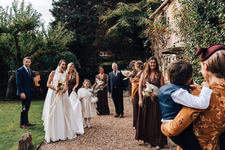 Bridal party arrive at Cripps Barn for October wedding