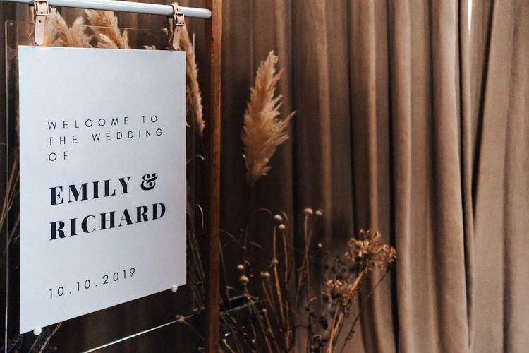 Monochrome wedding sign with pampas grass and dried flower decor at October wedding