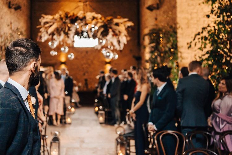 Groom waiting for bride to arrive at October wedding