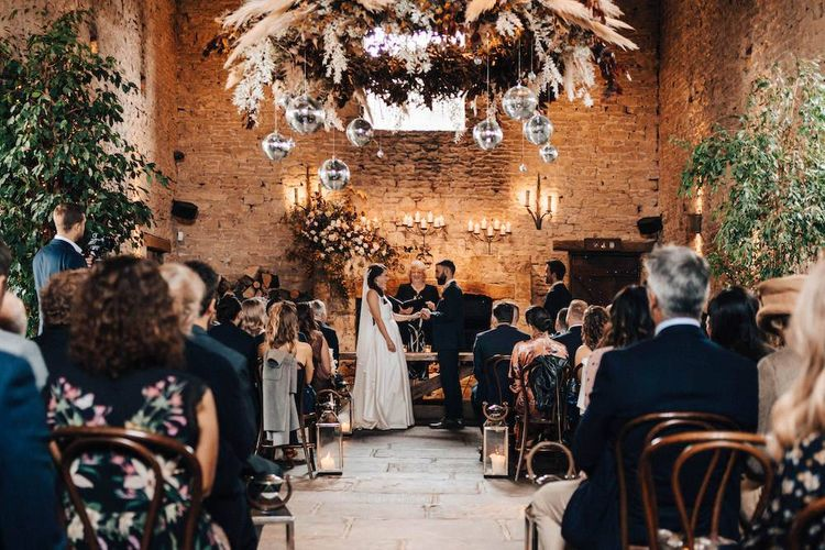 Beautiful October wedding ceremony with dried flower decor