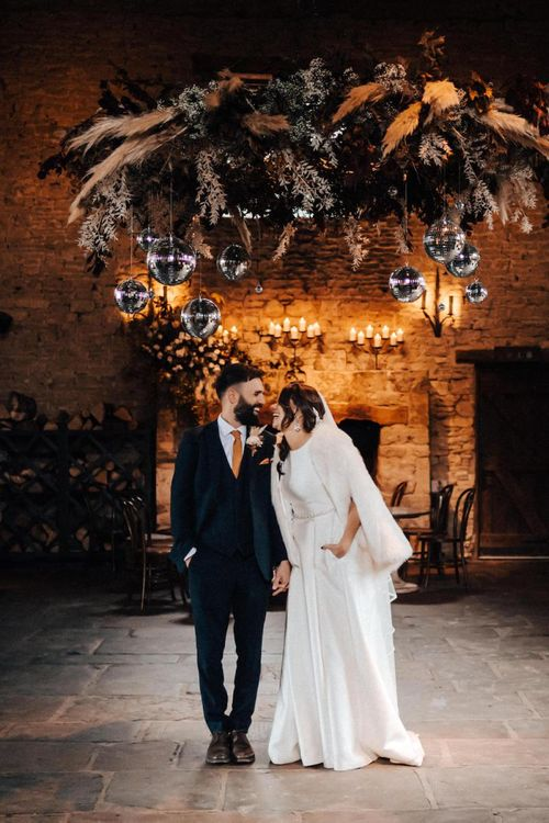 Bride in faux fur cover-up forAutumn wedding