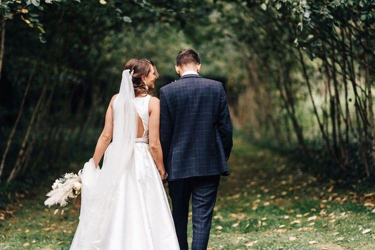 Open back bride dress by Jesus Peiro