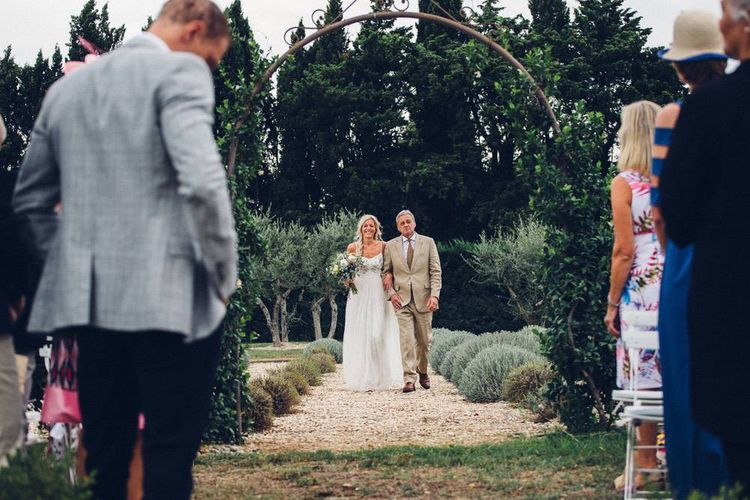 Wedding Ceremony Bridal Entrance in Needle & Thread Wedding Dress | Outdoor Destination Wedding at Le Peit Hameau Wedding Venue Provence, South of France Planned by By Mademoiselle | Lovestruck Photography
