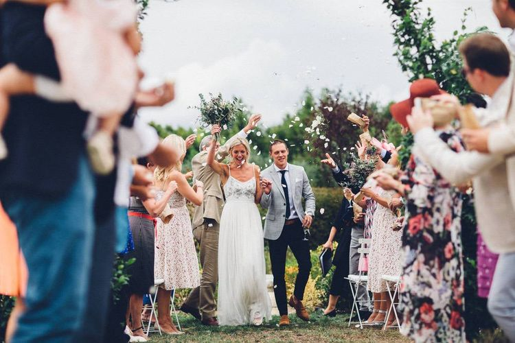 Confetti Moment | Bride in Needle & Thread Gown | Groom in Reiss Chinos & Blazer | Outdoor Destination Wedding at Le Peit Hameau Wedding Venue Provence, South of France Planned by By Mademoiselle | Lovestruck Photography