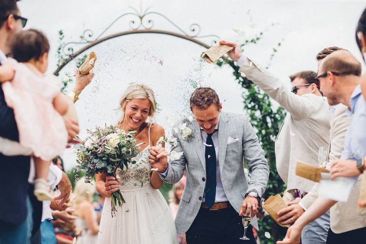 Confetti Exit | Bride in Needle & Thread Gown | Groom in Reiss Chinos & Blazer | Outdoor Destination Wedding at Le Peit Hameau Wedding Venue Provence, South of France Planned by By Mademoiselle | Lovestruck Photography