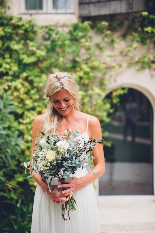 Bride in Needle & Thread Gown | Organic Wedding Bouquet |  Outdoor Destination Wedding at Le Peit Hameau Wedding Venue Provence, South of France Planned by By Mademoiselle | Lovestruck Photography