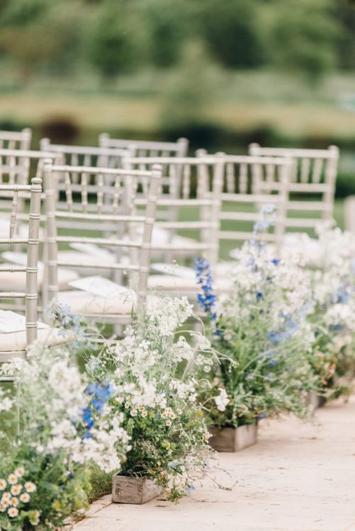 Blue and white aisle wedding flowers at Yorkshire Wedding Barn