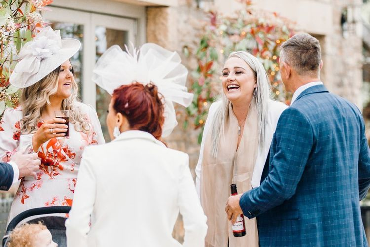 Wedding guests laughing and joking