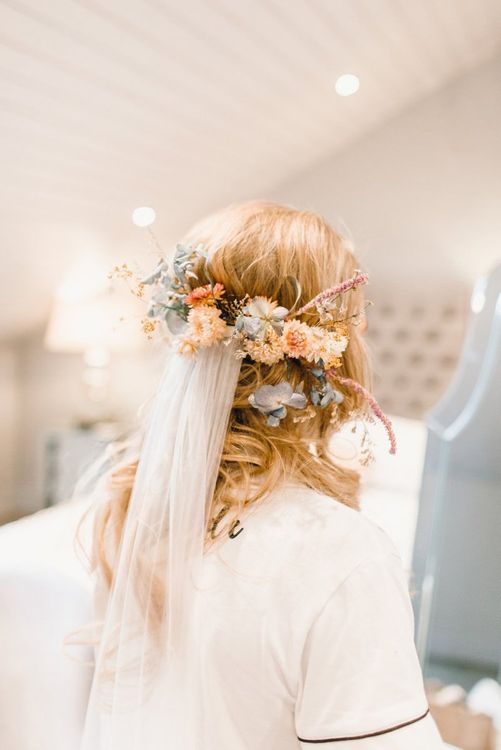 Bride on wedding morning with peach flowers in her hair