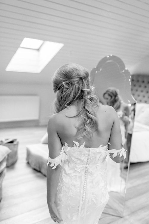 Bride on wedding morning in homemade wedding dress