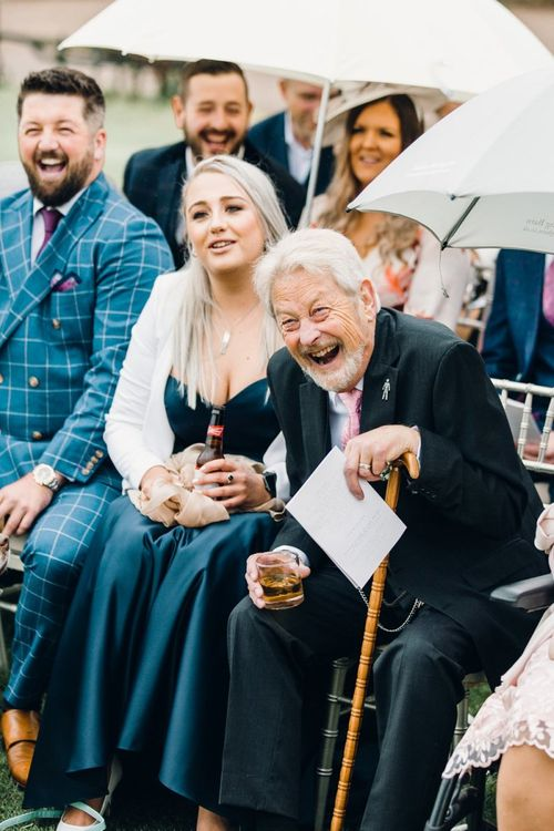 Wedding guest laughing during the ceremony