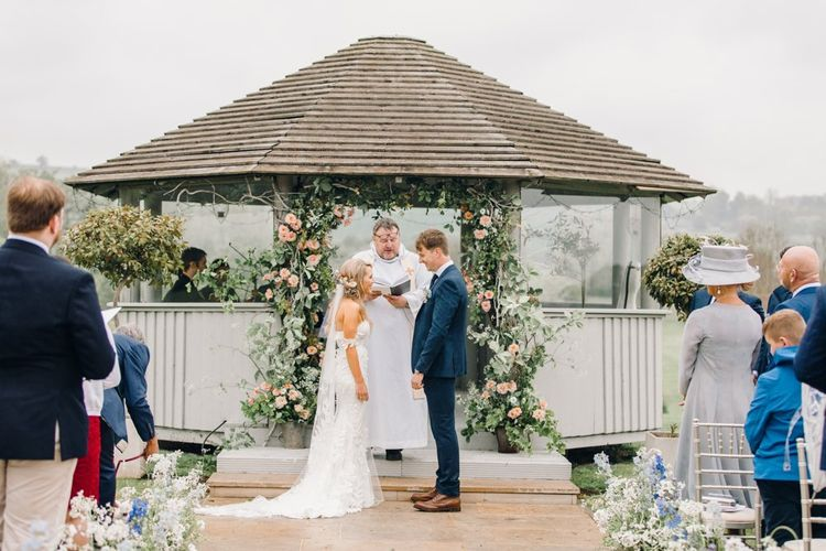 Bride and groom exchanging vows at Yorkshire Wedding Barn outdoor ceremony