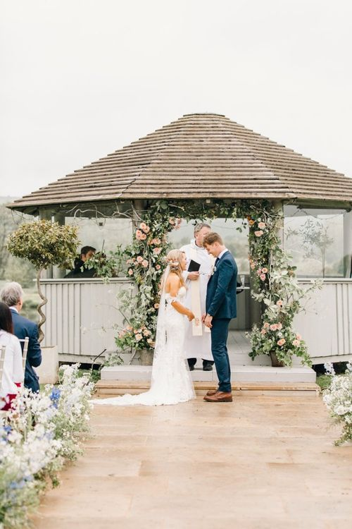 Bride and groom exchanging vows at outdoor ceremony