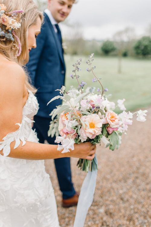 Romantic pastel wedding bouquet tied with ribbon