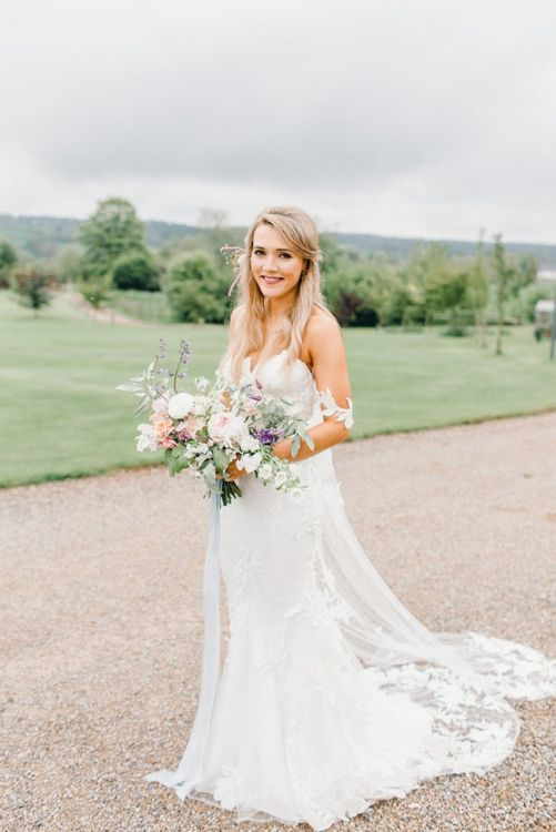 Bride in off the shoulder lace wedding dress made by her mum at Yorkshire Wedding Barn