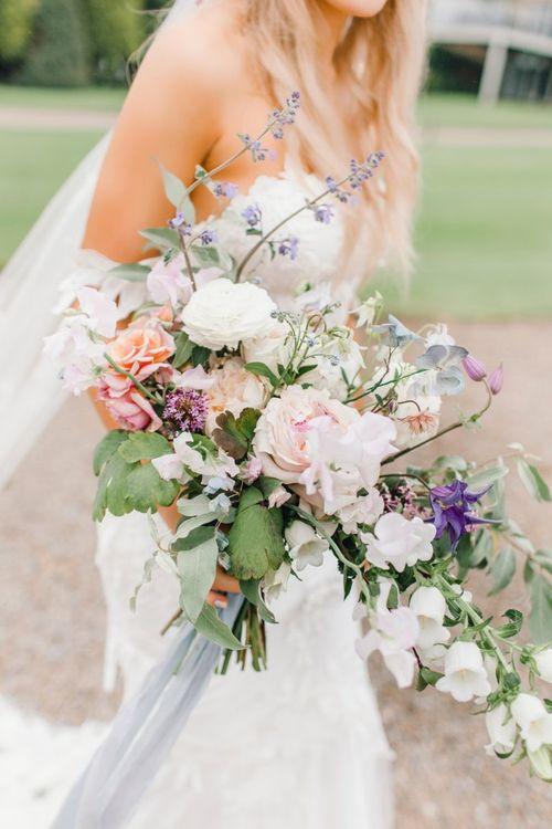 Hand tied romantic wedding bouquet at Yorkshire Wedding Barn