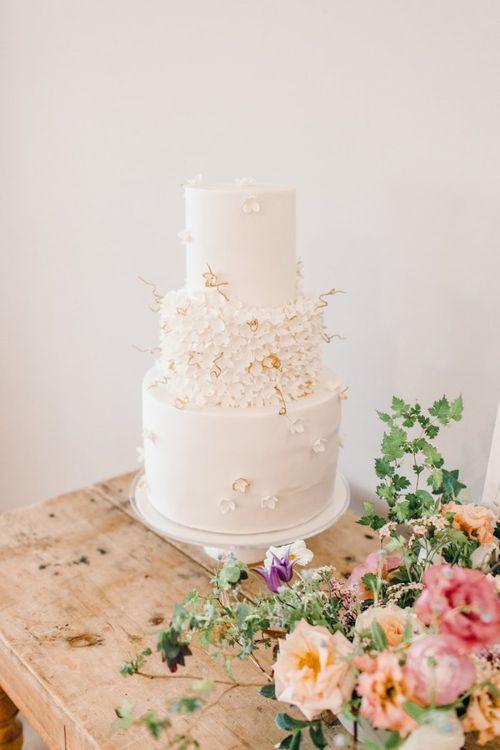 White wedding cake with intricate design at Yorkshire Wedding Barn