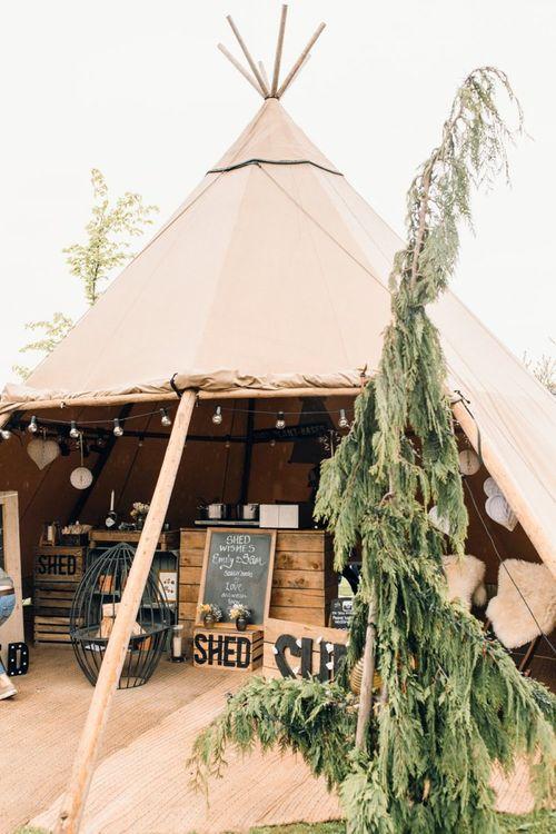 Rustic teepee bar at Yorkshire Wedding Barn