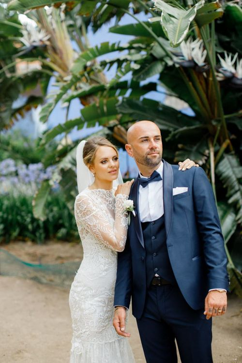 Elegant Bride and Groom in Lace Dress and Navy Suit