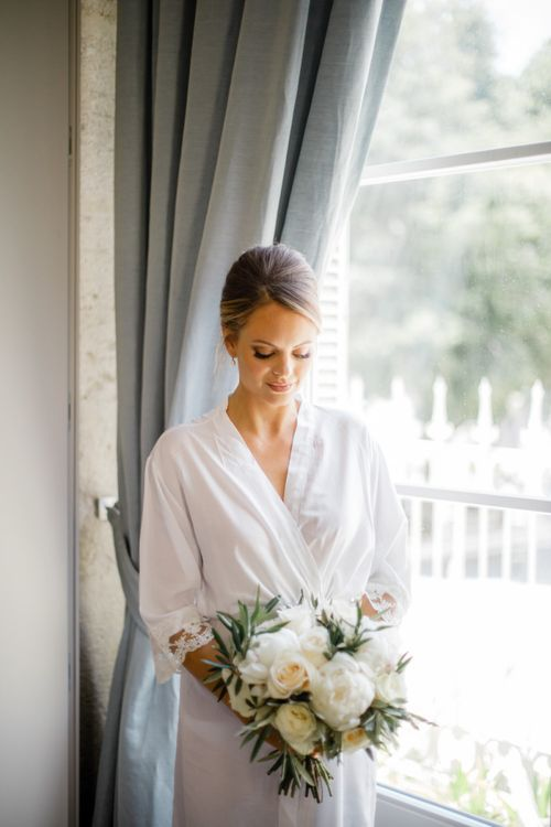 Bride with Chic Chignon Updo and Natural Makeup