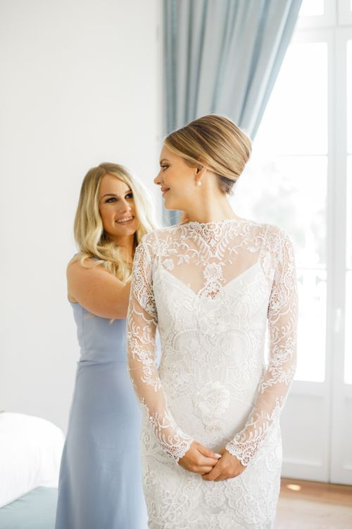 Bride Getting Ready in Lace Long Sleeve Wedding Dress