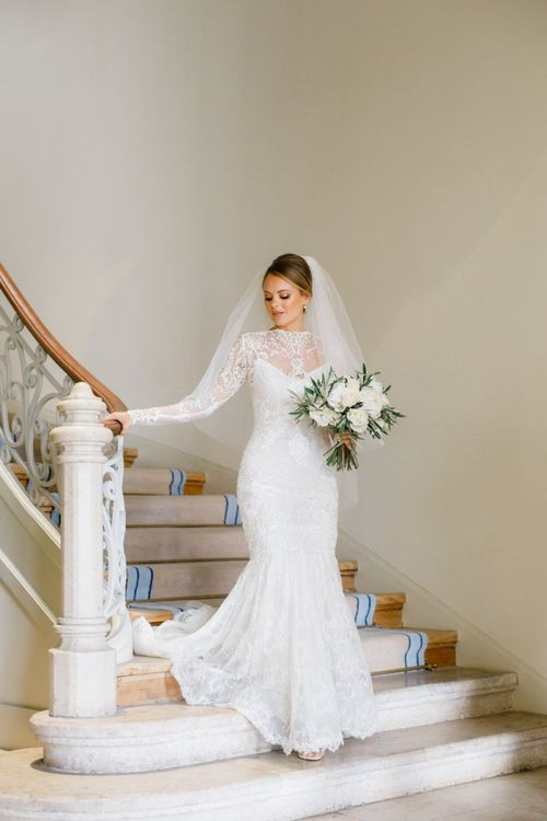 Bride in Yolan Cris Lace Wedding Dress with Long Sleeves and Fishtail Skirt