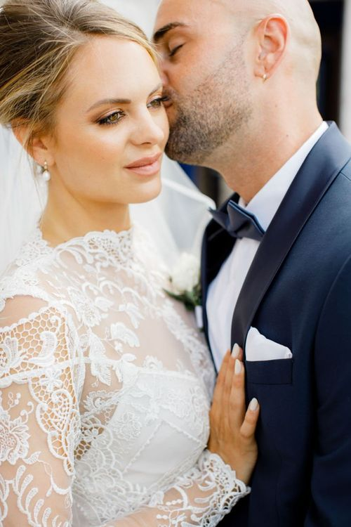 Bride in Lace High Neck Wedding Dress with Natural Bridal Makeup and Chic Updo