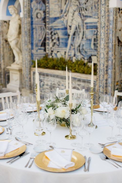 Table Decor with Gold Candlesticks and White Floral Arrangement