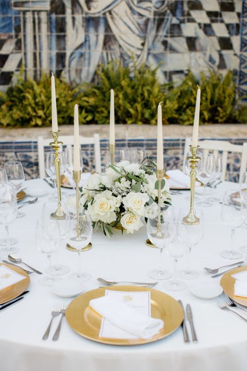 Gold Platter Place Setting, White Flower Centrepiece and Taper Candles