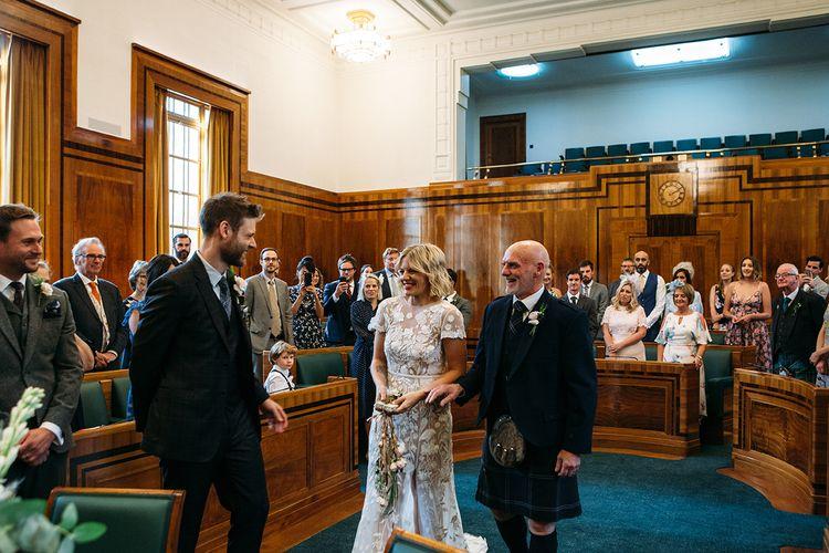 Wedding Ceremony Bridal Entrance at Hackney Town Hall in Lace Hermione De Paula Wedding Dress